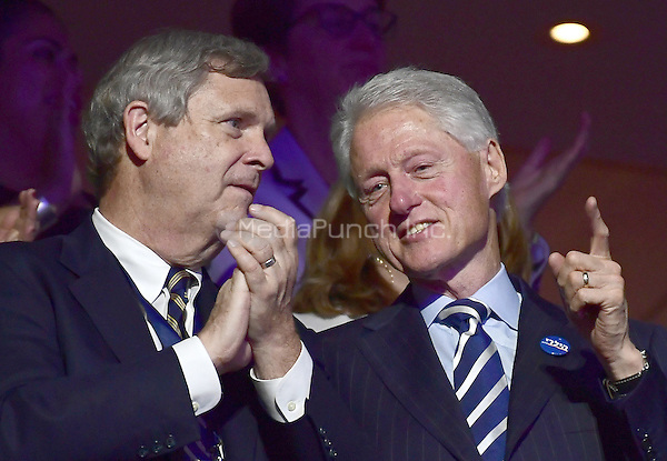 Former United States President Bill Clinton, wearing a button that says &quot;Hillary&quot; in Hebrew, shares some thoughts with US Secretary of Agriculture Tom Vlsack during the third session of the 2016 Democratic National Convention at the Wells Fargo Center in Philadelphia, Pennsylvania on Wednesday, July 27, 2016.<br /> Credit: Ron Sachs / CNP/MediaPunch<br /> (RESTRICTION: NO New York or New Jersey Newspapers or newspapers within a 75 mile radius of New York City)