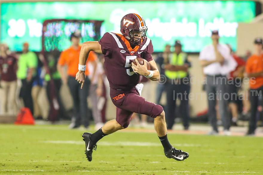 Blacksburg, VA - October 6, 2018: Virginia Tech Hokies quarterback Ryan Willis (5) runs the ball during the game between Notre Dame and VA Tech at  Lane Stadium in Blacksburg, VA.   (Photo by Elliott Brown/Media Images International)
