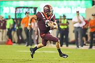 Blacksburg, VA - October 6, 2018: Virginia Tech Hokies quarterback Ryan Willis (5) runs the ball during the game between Notre Dame and VA Tech at  Lane Stadium in Blacksburg, VA.   (Photo by Elliott Brown/Media Images International)