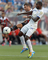 AC Milan forward Antonio Cassano (99) takes a shot as C.D. Olimpia defender Johnny Palacios (30) defends. In an international friendly, AC Milan defeated C.D. Olimpia, 3-1, at Gillette Stadium on August 4, 2012.