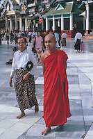 Worshippers circle the giant main terrace of the Shwedagon Pagoda.