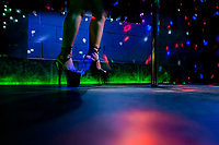 A Salvadoran sex worker's feet in high heel shoes are seen during the erotic pole dance performance in a sex club in San Salvador, El Salvador, 13 November 2016. Sex workers' task in the club is to be an entertaining and seductive companion. Performing erotic dance on the pole they make the customers stay as long as possible and buy relatively expensive alcoholic beverages from which they have a certain share. Sex workers are not obliged to have sexual intercourse with the club customers, they decide themselves, usually according to their current economic situation.