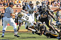 "MU free safety William Moore tackles Western Michigan Broncos running back Brandon West on an an eight yard run as Umpire John ""Butch"" Mascarello gets an up close look during the fourth quarter at Memorial Stadium in Columbia, Missouri on September 15, 2007. The Tigers won 52-24."