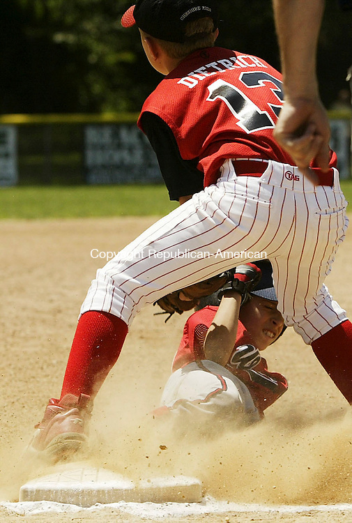 BEACON FALLS, CT 10 July 2005 -071005BZ03-  Wolcott #21. Christian Parafati slides safely into third base under the tag of Cheshire #13, Eric Dietrich<br /> during the championship game of the Willie Mays Baseball Tournament in Beacon Falls Sunday. <br /> Jamison C. Bazinet Photo