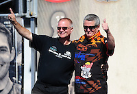 Aug. 21, 2011; Brainerd, MN, USA: NHRA funny car driver Dale Creasy Jr (right) with Tim Wilkerson during the Lucas Oil Nationals at Brainerd International Raceway. Mandatory Credit: Mark J. Rebilas-