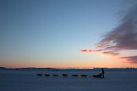 Tollef Monson departs Unalakleet at dawn. Photo by Jon Little.