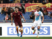 Roma&rsquo;s Diego Perotti, left, is chased by Napoli&rsquo;s Faouzi Ghoulam in action during the Italian Serie A football match between Roma and Napoli at Rome's Olympic stadium, 4 March 2017. <br /> UPDATE IMAGES PRESS/Isabella Bonotto