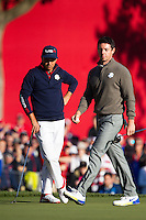 Ricky Fowler (Team USA) and Rory McIlroy (Team Europe) on the 8th green during the Saturday morning Foursomes at the Ryder Cup, Hazeltine national Golf Club, Chaska, Minnesota, USA.  01/10/2016<br /> Picture: Golffile | Fran Caffrey<br /> <br /> <br /> All photo usage must carry mandatory copyright credit (&copy; Golffile | Fran Caffrey)