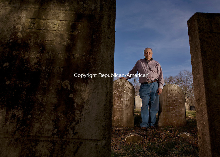 OXFORD,CT- 17 APRIL 2009-041709BF03--  Robert DeBisschop, President of the Southford Cemetery Association, poses near the graves of Oxford residents Harvey and Esther Bronson who were buried in the late 1870's. The Southford Cemetery in Oxford consists of 3-4 acres and has about 450 graves at it's location at the corner of Hawley Road and Route 67.     Bob Falcetti Republican-American