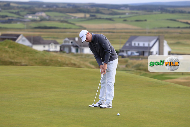 Paul McBride (The Island) on the 1st green during Matchplay Round 1 of the South of Ireland Amateur Open Championship at LaHinch Golf Club on Friday 24th July 2015.<br /> Picture:  Golffile | Thos Caffrey
