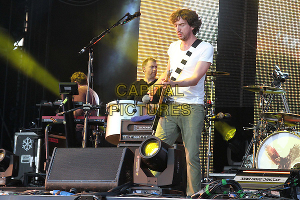 Snow Patrol - Gary Lightbody.V Festival 2012 - Day Two, Hylands Park, Chelmsford, Essex, England..August 19th 2012.on stage in concert live gig performance music full 3/4 length black white t-shirt guitar    black jeans denim .CAP/JIL.©Jill Mayhew/Capital Pictures