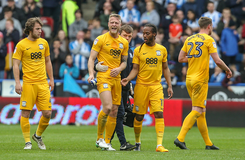 Preston North End's Tom Clarke leaves the field in pain<br /> <br /> Photographer Alex Dodd/CameraSport<br /> <br /> The EFL Sky Bet Championship - Huddersfield Town v Preston North End - Friday 14th April 2016 - The John Smith's Stadium - Huddersfield<br /> <br /> World Copyright &copy; 2017 CameraSport. All rights reserved. 43 Linden Ave. Countesthorpe. Leicester. England. LE8 5PG - Tel: +44 (0) 116 277 4147 - admin@camerasport.com - www.camerasport.com