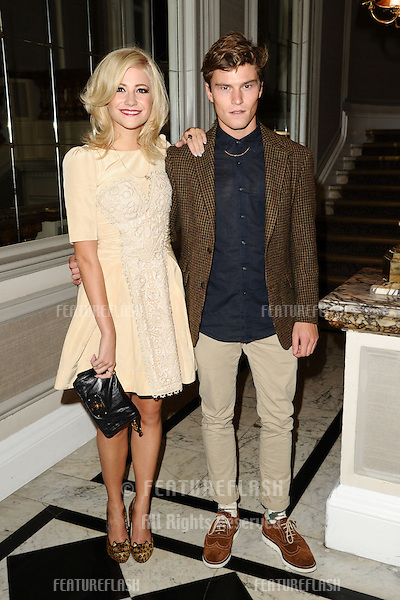Pixie Lott and boyfriend, Oliver Cheshire arriving at the Temperley catwalk show as part of London Fashion Week SS13, New Connaught Rooms, Covent Garden, London. 16/09/2012 Picture by: Steve Vas / Featureflash