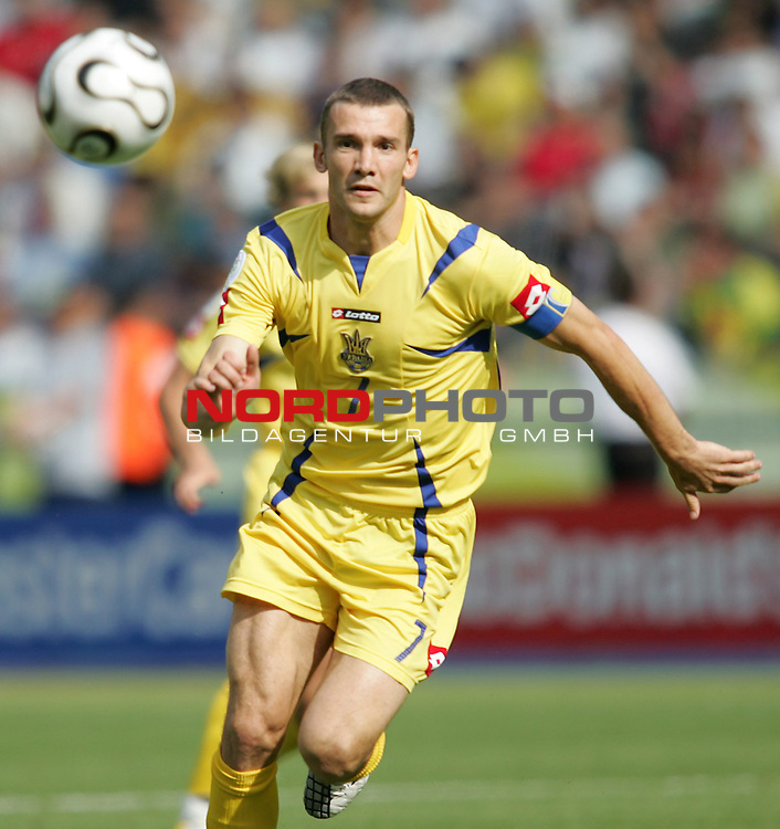 FIFA WM 2006 - Gruppe H ( Group H )<br /> Play #48 (23-Jun) - Ukraine vs Tunisia.<br /> Andriy Shevchenko from Ukraine faces the ball during the match of the World Cup in Berlin.<br /> Foto &copy; nordphoto