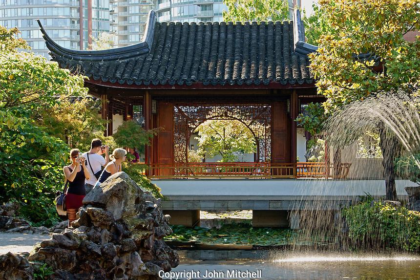 Tourists taking photos in Dr Sun Yat-Sen Park, Chinatown, Vancouver, British Columbia, Canada