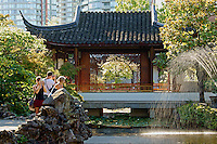 Tourists taking photos in Dr Sun Yat-Sen Park, Chinatown, Vancouver, British Columbia, Canada