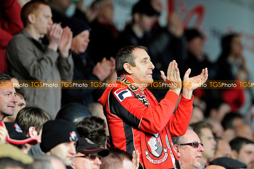 An AFC Bournemouth  supporter applauds his team at the end of the match- AFC Bournemouth vs Liverpool - FA Cup 4th Round Football at the Goldsands Stadium, Bournemouth, Dorset - 25/01/14 - MANDATORY CREDIT: Denis Murphy/TGSPHOTO - Self billing applies where appropriate - 0845 094 6026 - contact@tgsphoto.co.uk - NO UNPAID USE