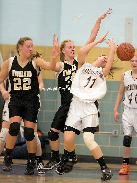 Waterbury, CT-22, February 2010-022210CM11  The ball slips through the hands of Torrington's Kayla Langenheim Monday night at Kennedy High School in Waterbury.  To the left are Woodland's Katie Alfiere (#22) and Heather Framski (#34).  To the right is Torrington's Sarah Royals. Torrington  defeated Woodland 53-49 Monday night at Kennedy High School.  They advanced to the finals to meet Holy Cross, and will play Wednesday night. --Christopher Massa Republican-American
