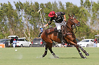 WELLINGTON, FL - APRIL 15:  Agustin Oregon of Palm Beach Illustrated hits a backshot. Scenes from the $100,000 World Cup Final, at the Grand Champions Polo Club, on April 15, 2017 in Wellington, Florida. (Photo by Liz Lamont/Eclipse Sportswire/Getty Images)