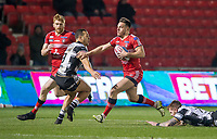 Picture by Allan McKenzie/SWpix.com - 16/03/2018 - Rugby League - Betfred Super League - Salford Red Devils v Hull FC - AJ Bell Stadium, Salford, England - Salford's Niall Evalds fends off hull FC's Carlos Tuimavave.