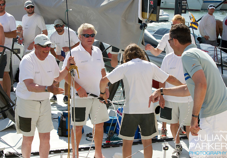 King Harald of Norway chats to Crown Prince Felipe of Spain at The Royal Yacht Club, in Palma, Mallorca..after competing in the first day of the Copa Del Rey sailing regatta