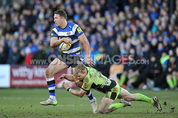 Sam Burgess of Bath Rugby looks to get past Tom Stephenson of Northampton Saints. Aviva Premiership match, between Bath Rugby and Northampton Saints on February 21, 2015 at the Recreation Ground in Bath, England. Photo by: Patrick Khachfe / Onside Images