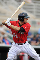 Right fielder Jacob Morris (24) of the Kannapolis Intimidators bats in a game against the Charleston RiverDogs on Saturday, June 28, 2014, at CMC-Northeast Stadium in Kannapolis, North Carolina. Kannapolis won, 4-3. (Tom Priddy/Four Seam Images)