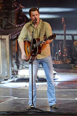 SUNRISE FL - NOVEMBER 17: Easton Corbin performs at The BB&T Center on November 17, 2016 in Sunrise, Florida. Credit: mpi04/MediaPunch