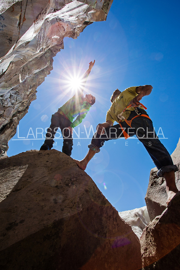 Checking out our options for some dry rock at the Gran Pared (main sector), Valle des los Condores. Climbers:<br /> Lucho Birkner, Tomas Contreras