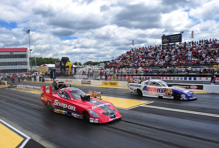 May 15, 2011; Commerce, GA, USA: NHRA funny car driver Cruz Pedregon (left) races alongside Jack Beckman during the Southern Nationals at Atlanta Dragway. Mandatory Credit: Mark J. Rebilas-