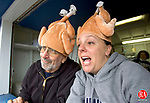 WATERBURY, CT. 25 November 2010-112520SV10--From left, Joe DeLucia and Leslie Silva staff the snack bar at Crosby High on Thanksgiving in Waterbury Thursday. They call themselves the Bull Dog Turkeys.<br /> Steven Valenti Republican-American