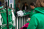 Home fans looking at the souvenir stand as Guernsey take on Corinthian-Casuals in a Isthmian League Division One South match at Footes Lane. Formed in 2011, Guernsey FC are a community club located in St. Peter Port on the island of Guernsey and were promoted to the Isthmian League Division One South in 2013. The visitors from Kingston upon Thames won the fixture by 1-0, watched by a crowd of 614 spectators.