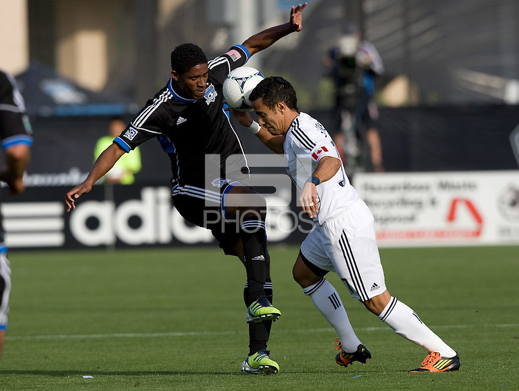 Khari Stephenson of Earthquakes fights for the ball against Camilo of Whitecaps during the game at Buck Shaw Stadium in Santa Clara, California on April 7th, 2012.  San Jose Earthquakes defeated Vancouver Whitecaps, 3-1.