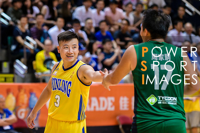 Liang Man Hung #3 of Winling Basketball Club shakes hands with Chow Ka Kui #17 of Tycoon Basketball Team after the Hong Kong Basketball League playoff game between Winling and Tycoon at Queen Elizabeth Stadium on July 24, 2018 in Hong Kong. Photo by Marcio Rodrigo Machado / Power Sport Images