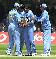 .29/06/2002.Sport - Cricket - .NatWest triangler Series England - Sri Lanka - India.England vs india 50 overs.  Lord's ground.England batting -  Sourav Ganguly is congratulated by team mates for the wicket of Marcus Trescothick  - caught Dravid bowled Ganguly. ..