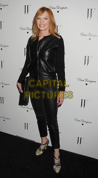 Marg Helgenberger.W Magazine's 69th Annual Golden Globe Awards Celebration held at The Chateau Marmont, West Hollywood, California, USA..13th January 2012.full length trousers clutch bag leather jacket  black   .CAP/ROT/TM.©Tony Michaels/Roth Stock/Capital Pictures