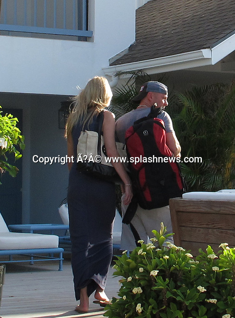 EXCLUSIVE: Super Star country singer Kenny Chesney on holiday in St Barth in the Caribbean.<br /><br />Pictured: Amy Colley, Kenny Chesney<br /><br />Ref: SPL345968  281211   EXCLUSIVE<br />Picture by: CelebrityVibe / Splash News<br /><br />Splash News and Pictures<br />Los Angeles:310-821-2666<br />New York:212-619-2666<br />London:870-934-2666<br />photodesk@splashnews.com