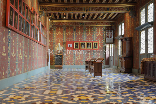Queen's Gallery, 16th century, in the apartment of Francois I and Catherine de Medici, in the Chateau Royal de Blois, built 13th - 17th century in Blois in the Loire Valley, Loir-et-Cher, Centre, France. The terracotta floor tiles are by Felix Duban, made in the 19th century following a 15th century design. The gallery contains many portraits and painted walls and ceiling, and was used for strolling, music and dance. The chateau has 564 rooms and 75 staircases and is listed as a historic monument and UNESCO World Heritage Site. Picture by Manuel Cohen