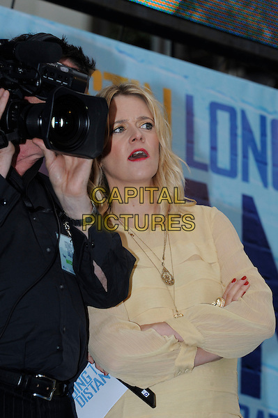 EDITH BOWMAN.At the 'Going the Distance' world premiere at the Vue cinema, Leicester Square, London, England, UK, .19th August 2010..half length yellow ruffle dress gold necklace cameraman camera.CAP/IA.©Ian Allis/Capital Pictures.