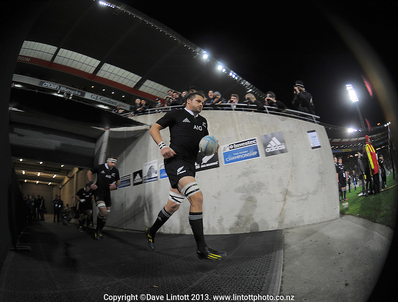 Richie McCaw leads his team out during the Rugby Championship international rugby Bledisloe Cup test match between All Blacks and Australia at Westpac Stadium, Wellington, New Zealand on Saturday, 24 August 2013. Photo: Dave Lintott / lintottphoto.co.nz