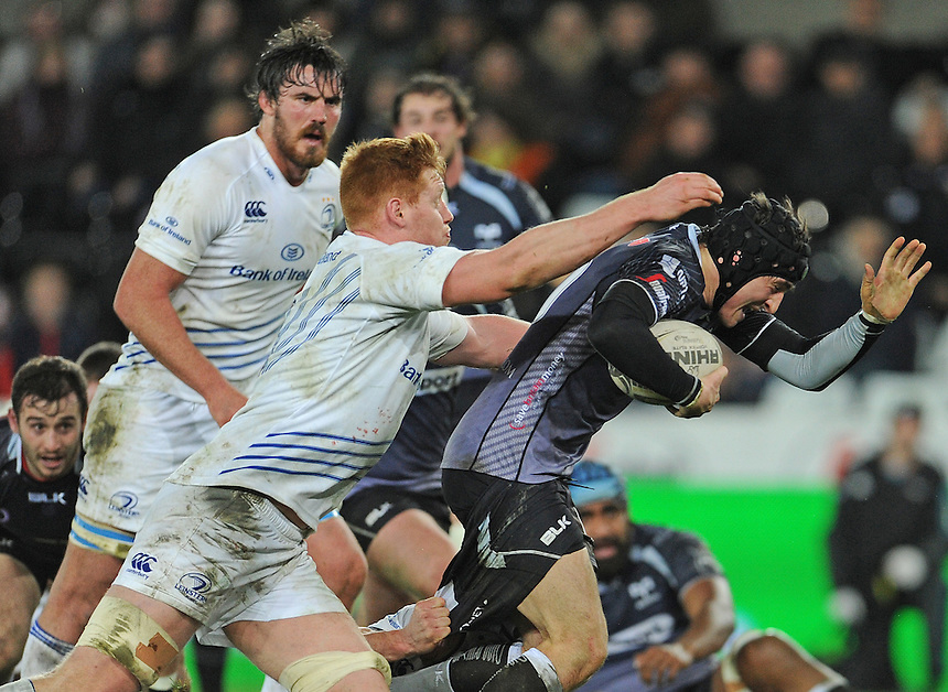 Ospreys' Sam Davies is tackled by Leinster's Tom Denton<br /> <br /> Photographer Ian Cook/CameraSport<br /> <br /> Rugby Union - Guinness PRO12 - Ospreys V Leinster - Friday 27th February 2015 - Liberty Stadium - Swansea<br /> <br /> &copy; CameraSport - 43 Linden Ave. Countesthorpe. Leicester. England. LE8 5PG - Tel: +44 (0) 116 277 4147 - admin@camerasport.com - www.camerasport.com