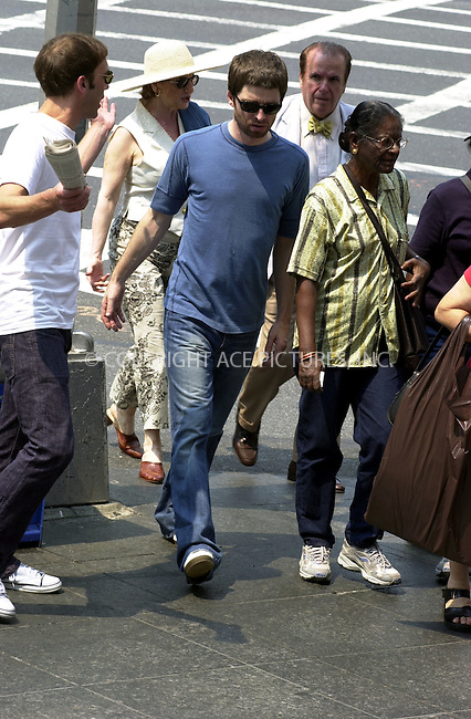 ***EXCLUSIVE***..Oasis guitarist Noel Gallagher hiding from ferocious New York sun behind dark sunglasses as he takes mid-afternoon stroll on Madison Avenue in New York. Oasis rocked Beacon Theatre last night after which Noel attended the concert after-party where he apparently had quite a few drinks. In the end, Noel had to be helped in and out of the van. August 14, 2002. Please byline: Alecsey Boldeskul/NY Photo Press.   ..*PAY-PER-USE*      ....NY Photo Press:  ..phone (646) 267-6913;   ..e-mail: info@nyphotopress.com