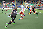 The Hague, Netherlands, June 08: Phil Burrows #18 of New Zealand passes the ball into the circle during the field hockey group match (Men - Group B) between the Black Sticks of New Zealand and Germany on June 8, 2014 during the World Cup 2014 at Kyocera Stadium in The Hague, Netherlands.  Final score 3-5 (1-3) (Photo by Dirk Markgraf / www.265-images.com) *** Local caption ***