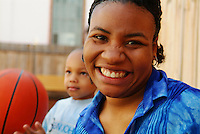 African American Mom and Son with a Basketball