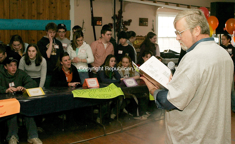 WOODBURY, CT- 27 FEBRUARY 2005-022705J09-Event M.C. Tom Casteel, right, asks trivia questions to contestants during the 'Ultimate Games' held Sunday at the Voegli Miniature Horse Farm in Woodbury. The event, in which local high school students face off in a series of challenges, was sponsored by the Woodbury's church communities and presented by St. Teresa of Avila Church. --- Jim Shannon Photo--St. Teresa of Avila Church; Voegli Miniature Horse Farm; Woodbury; Katelyn Broderick; Katie Cornwell, Kelly Anderson are CQ