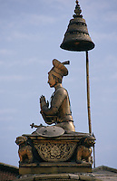 Roofs of temples, monasteries and other religious buildings in Nepal are often highly ornamented. This striking bronze of a soldier in Bhaktapur makes a wonderful silhouette against the blue sky.