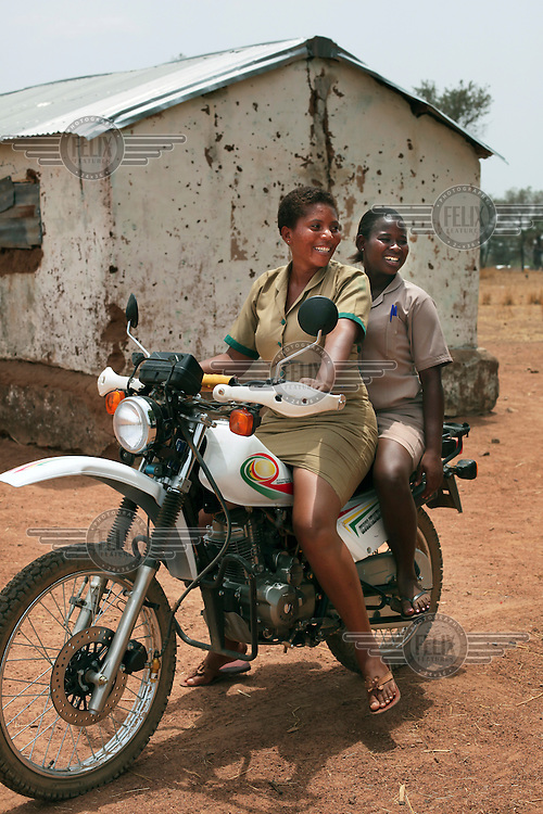 24 year old Nurse Linda Mbe (left) on a Ghana Health Service Motorbike with a colleague, which is used to transport pregnant women from Kunkua village to the local hospital when complications arise during labour. The Upper East Region has only 9 doctors in the entire region, meaning 1 doctor to every 1 million patients.