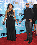 Angela Bassett and Romeo at The 42nd Annual NAACP Awards held at The Shrine Auditorium in Los Angeles, California on March 04,2011                                                                   Copyright 2010  Hollywood Press Agency