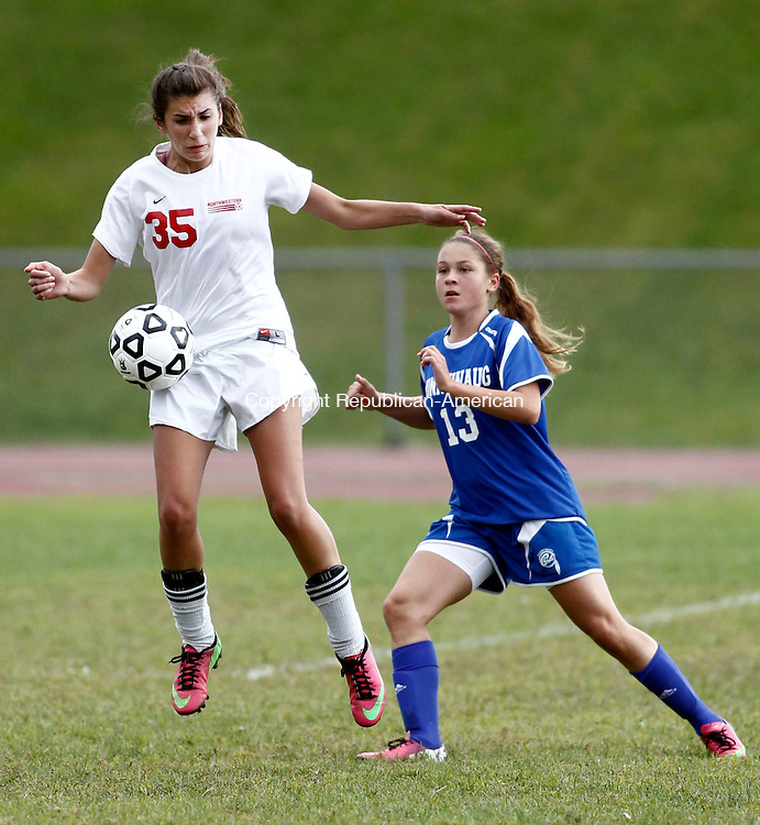 Winsted, CT- 16 September 2013-091613CM14-Northwestern's Kaitlyn Solak, left, receives the ball as Nonnewaug's Emma Harter moves in during Berkshire League soccer action in Winsted Monday afternoon.    Christopher Massa Republican-American