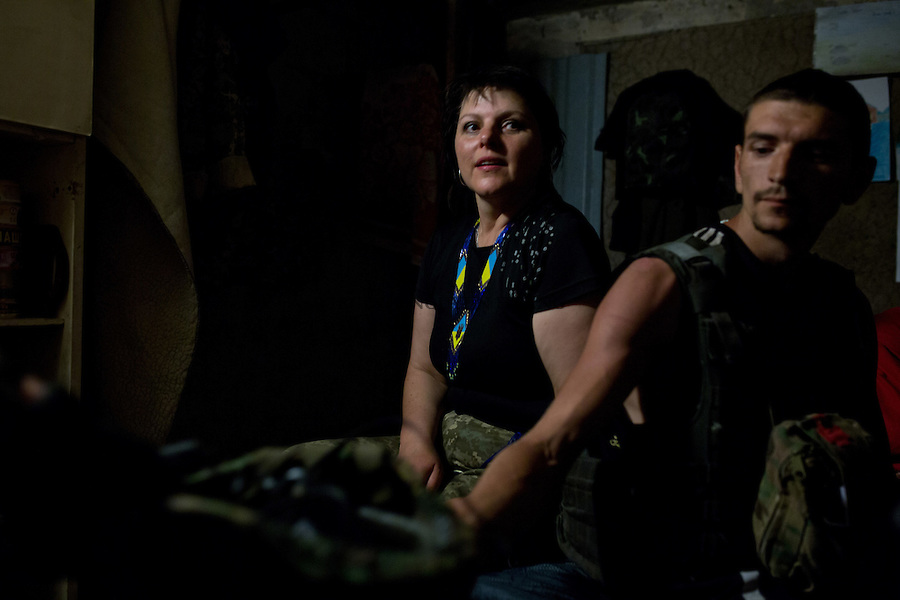 UKRAINE, Pisky: Irene, Mama's assistant is waiting in the underground shelter that shelling stops. Irene is also a medic and assure the first aid treatment at the base when Mama has to go to the frontline. <br /> <br /> UKRAINE, Pisky: Irene, l'assistante de Mama attend dans l'abri souterrain les bombardements cessent. Irene est aussi m&eacute;decin et assure les premiers soins &agrave; la base quand Mama doit se rendre &agrave; la ligne de front.